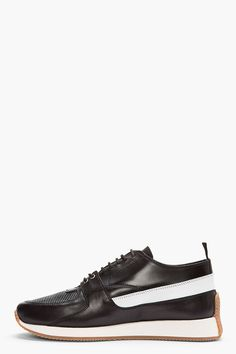 KRISVANASSCHE //  Black & white leather low-top sneakers  32134M050002  Low-top leather sneakers in black and white. Round toe. Tonal lace-up closure. Pull tab at heel. Pebbled panel at apron. White sole walls, tan sole. Tonal stitching.  $965 CAD