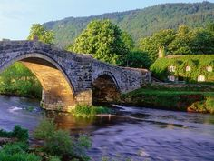 We ♥ the colours in this photo! 'Bridge and river in Llanrwst, Wales. Llanrwst is a town near to Betws-Y-Coed, a short distance from the A5 route across north Wales and surrounded by lovely countryside.'