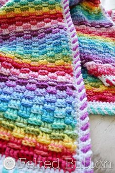 Basket of Rainbows Blanket Crochet Pattern by Felted Button. Love the border on this