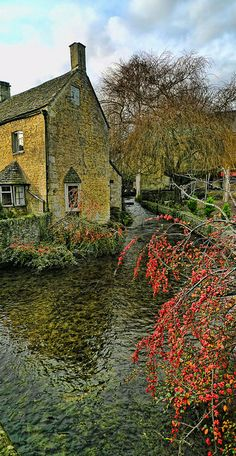 Bourton-on-the-Water is a village and civil parish in Gloucestershire, England that lies on a wide flat vale within the Cotswolds Area of Outstanding Natural Beauty.   Go to www.YourTravelVideos.com or just click on photo for home videos and much more on sites like this.