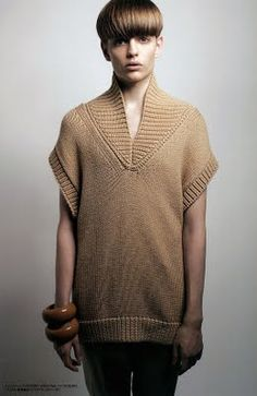 wonderful short-sleeve sweater, photographed by Hiroshi Kutom for the November issue of HUgE magazine. Young Pawel Bednarek was styled by Shinichi Miter in Fujiwara's minimalistic but stylish garments, and adorned him with exquisite large wooden wristlets.