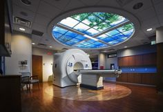 The ceiling provides nature views to reduce the harshness of technology and enhance the patient experience.