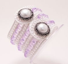 This cuff would be perfect for a Western style wedding. The faceted crystals are 6mm by 8mm and fill three rows. In between each row there are 3mm white faux pearls for a total of 7 beautiful rows of cuff. With the white leather it can be worn with a white outfit or even a pale lavender outfit and would also be a gorgeous gift for a blushing bride.  Fits a 7'' wrist snug but comfortably  $65.00