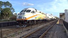 Orlando SunRail Commuter Trains 100 + 109 Arriving And Departing At Orla...