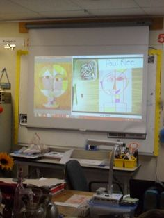 """You can see where I am using the Document camera to draw the face and I have Paul Klee's painting right next to my drawing. That way the students can see how I am creating a portrait like the """"Senecio""""."""