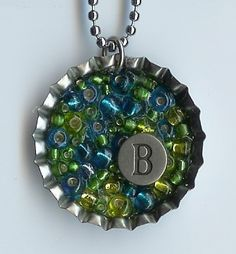bottle cap Filled with Beads. Choose your favorite colors for the beads and your initial. Bottle Cap Jewelry, Bottle Cap Necklace, Bottle Cap Art, Bottle Cap Images, Diy Necklace, Bottle Top Crafts, Bottle Cap Projects, Resin Jewelry, Jewelry Crafts