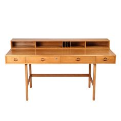 Iconic flip top desk by Peter Løvig Nielsen for Løvig  Denmark  1960's  Danish icon desk in oak, full of wood grain. Design often attributed to Jens Quistgaard.   Brass hinged flip top compartment allows this desk to expand for a partner, into a conference or dining table.