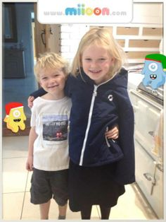 Maisey and Hector wearing their Moshi T-shirt and Rucjack creations