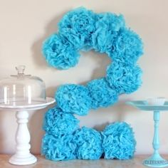 Decorate a birthday party or use as a photo prop- tissue pom pom flower numbers! Tutorial with step by step directions and lots of pictures!