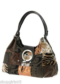 NEW! BEAUTIFUL DESIGNER INSPIRED ANIMAL PRINT PURSE.   HAS ZIP TOP CLOSURE. INSIDE , HAS POCKET  ONE SIDE AND ZIP COMPARTMENT . MEASURES APPROX. 17 INCHES WIDE BY 10 INCHES TALL AND 6 INCHES DEEP. REALLY PRETTY!!!!