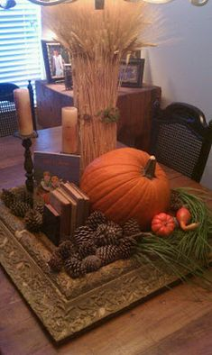 Vintage Autumn Centerpiece...start with an old large frame or mirror and add fall decorations, candles & pumpkins to create a fabulous table vignette.