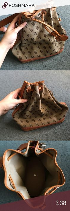 Dooney & Bourke drawstring bag Nude, medium-sized Dooney & Bourke drawstring handbag in wonderful condition! Dooney & Bourke Bags