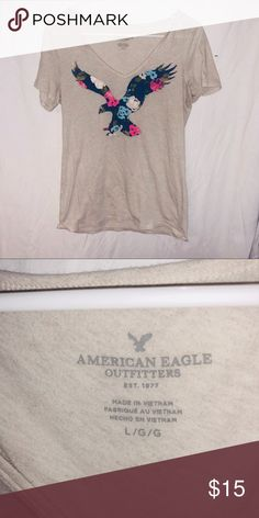 Large American eagle v neck tee with floral design Tan American eagle v neck tee with floral bird. Size large. American Eagle Outfitters Tops Tees - Short Sleeve