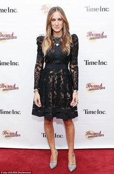 Ace in lace: Sarah Jessica Parker, 50, looked incredible in a black midi dress as she atte...