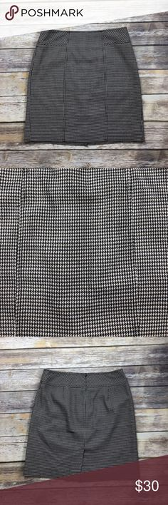 Ann Taylor Loft Houndstooth Skirt Houndstooth skirt in a size 6. Zippers in the back. Waist is approx 32 inches and length is approx 19. Great trendy pattern for this fall. Pattern is black, tan, and grey. No trades or modeling. I am always open to offers and if you bundle your favorite items then I can send you a private offer! 028 Ann Taylor Loft Skirts