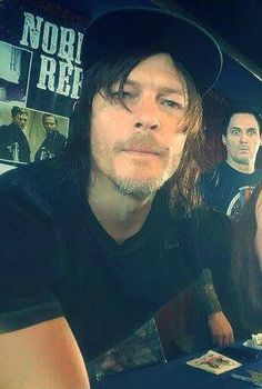 Norman and photo-bomber
