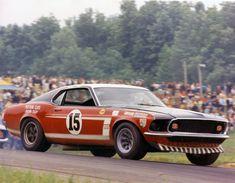 Parnelli Jones in a Bud Moore Trans Am '69 Mustang Boss 302.