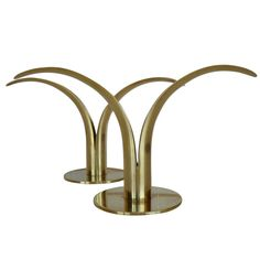 These gorgeous brass candle holders would make a wonderful mid-century gift for anybody! Click through for more information.