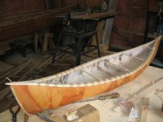 The finished canoe   Step 1: Preparing building frame, cedar sheating and ribs  Step 2: Gathering a suitable piece of bark ( winter ba...