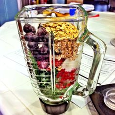 oatmeal, yogurt, milk, frozen strawberries blueberries and raspberries, and kale smoothie