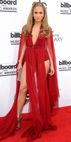 At the 2014 Billboard Music Awards, Jennifer Lopez turned up the heat in a skin-hugging bodysuit and sheer-paneled Donna Karan creation. Donna Karan, Celebrity Red Carpet, Celebrity Style, Jennifer Lopez Red Carpet, Versace Gown, Le Jolie, Billboard Music Awards, Red Carpet Looks, Red Carpet Dresses