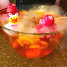 Pink punch with fruit and dry ice.