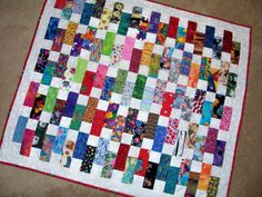 BABY BRICKS Quilt Ready to Ship from Quilts by Elena Scrap Quilt Bright and Colorful Novelty Fabrics. $80.00, via Etsy.