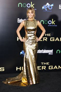 """Jennifer Lawrence in Prabal Gurung at the premiere of """"The Hunger Games"""" at Nokia Theater in LA on March 12, 2012. It's really difficult to pull this dress off—what with the cutouts, the voluminous skirt and the gold metallic color, but I think she looks pretty amazing. I love her hair & makeup."""