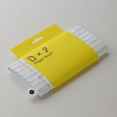 Paper Scarf. A scarf that looks like a notepad paper. However its not made of paper.