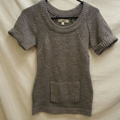 "Gray Short Sleeve Sweater Dress size S by L.e.i. Gray Short Sleeve Sweater Dress size S by L.e.i. This cute used sweater dress is in good used condition.  Waist: 14"" Length: 27.5""  Please let me know if you have questions. Happy Poshing!!! l.e.i. Sweaters"