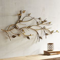 These little birds may not sing songs, but they will add a shiny sweetness to your interior style. The golden finish adds a modern element to the natural scene, creating a playful elegance that effortlessly incorporates into your decor. Metal Wall Decor, Home Decor Wall Art, Home Decor Furniture, Metal Wall Art, Diy Bedroom Decor, Art Decor, Diy Home Decor, Home Decor Trends, Home Decor Inspiration