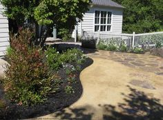 Landscape garden design in Kentfield, CA, replaced patchy lawn with eco-friendly materials and plantings