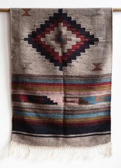 Produced by the Navajo people in the Four Corners area of the U.S., Navajo textiles typically have strong geometric patterns.  They are a flat tapestry-woven cloth produced in a way similar to kilims of Eastern Europe & Western Asia, but with some notable differences.   #textile #color #myt