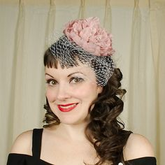Rose Floral Hair Fascinator:Ready to jazz up your hair with a fascinator? This little item is the cousin to a cocktail hat, but a lot easier to wear, it doesnt ruin your hair style and its super lightweight! Our fascinators are decorated with a pretty cage veil netting and 6 inch round multi layered flower. They are mounted to felt with a hair... $16.00