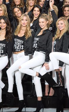 The models smile big during a photocall to mark the countdown to the '2016 Victoria's Secret' show in Paris, France - November 2016