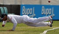 South Africa's Faf Du Plessis dives over the boundary rope and flicks the ball back in an attempt to stop four runs during the three-day cricket tour match against Australia 'A' at the Sydney Cricket Ground on November 2, 2012.