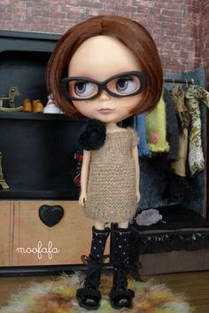 I don't like dolls but for some reason I can't take my eyes of this one. Her name is Blythe.