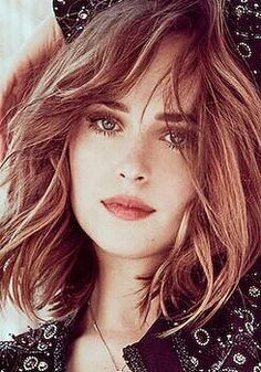 Dakota as Ana.   She looks so lovely here. Love the color of the hair