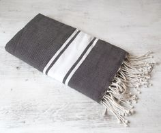 Crafted in Tunisia from 100% Egyptian cotton these traditional 'fouta' towels are as versatile as they are indispensable! Fine, soft luxury, use them at the beach, pool or bathroom as a towel, take them on your travels as the perfect throw or wrap, dress your lounge or favourite chair, take them on a picnic. The woven cotton will soften even more with use, rolls up neatly for easy packing, measures a generous 2m x 1m & is machine washable.