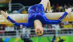 Britain's Claudia Fragapane falls while competing in the qualifying for the women's Beam event. - Emmanuel Dunand/AFP/Getty Images