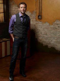 TJ Thyne in a grey vest and purple shirt. John Francis Daley, Bones Tv Series, Bones Tv Show, Emily Deschanel, David Boreanaz, Tj Thyne, Michaela Conlin, Booth And Bones, Man Crush Everyday