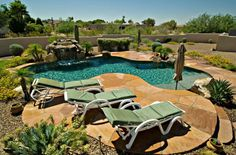 Beautiful natural #pool with rock waterfall, baja step, and flagstone deck. http://calpool.com
