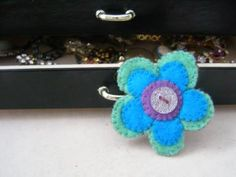 "This is SO adorable.  You should visit her shop on Zibbet.  ""Betty Blue"" Felt Flower Brooch by Puddleducks for $4.00"