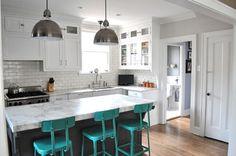 Bright bar stools, white and grey kitchen