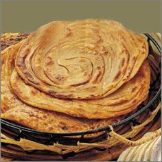 Laccha Parathas flaky whole wheat bread cooked in a Tandoor