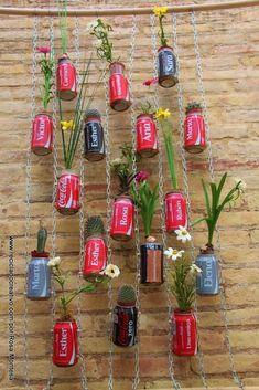 Reciclado Creativo en el patio. Jardines verticales con latas y cápsulas de café