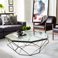 GEOMETRIC COFFEE TABLE | This is a geometric antique brass coffee table with glass top. It's beautiful modern center table | Discover more coffee tables ideas: www.bocadolobo.com #moderncoffeetables #luxurycoffeetables