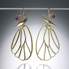 "Gabriella Kiss' ""Butterfly Cell"" earrings are a must-have!  Hand-sculpted and cast in 14K green gold, with tiny ruby briolettes adding a touch of color. These earrings measure 2 3/8"" x 1"" ., $2000"