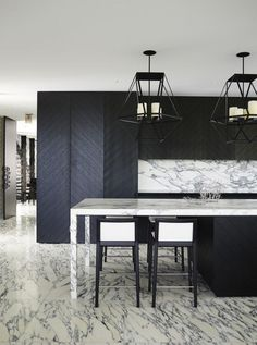 Charcoal Black & White & Grey If you're sticking to monochromatic, go all the way! This modern, sleek palette avoids being boring by introducing the large herringbone pattern on the cabinetry and the contrasting the dark wood with beautiful white and gray marble surfaces.