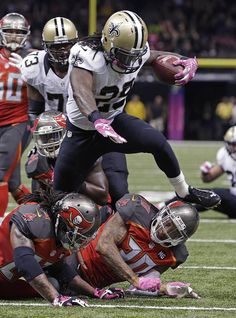 Saints outlast Bucs, 37-31 in OT - New Orleans Saints running back Khiry Robinson (29) carries on a game-winning touchdown run in overtime against the Tampa Bay Buccaneers in the second half of an NFL football game in New Orleans, Sunday, Oct. 5, 2014. (AP Photo/Jonathan Bachman)